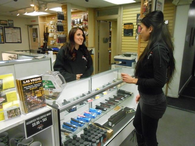 "Rachel Richards, left, and Nena Gruezo, salesclerks at The Gun Store, 2900 E. Tropicana Ave., chat Jan. 26, 2015, during a lull in business. Store owner Bob Irwin estimated that 20 percent, ""if no ..."