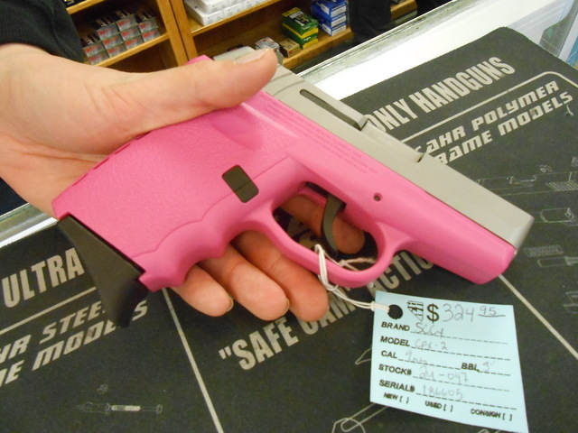 Rachel Richards holds a ​9mm ​pink gun in ​her ​hand Jan. 26, 2015, at The Gun Store. She said every gun manufacturer makes pink guns to appeal to the female market, and she estimated that ...
