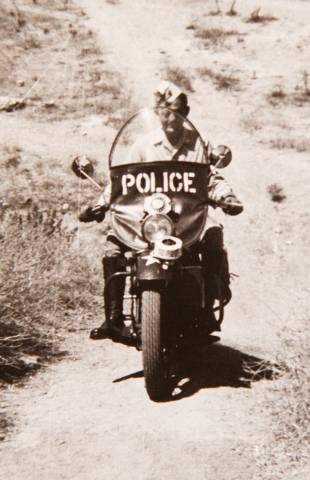 U.S. Army military policeman Gene Stephens rides a motorcycle in this vintage photograph taken in North Africa in the 1940s during World War II. The photo is shown in the Sun City Summerlin home o ...