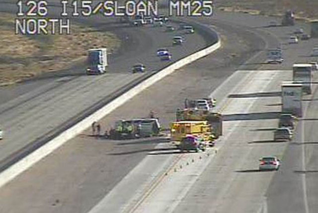 Six people were in an SUV that rolled over on northbound Interstate 15 near Sloan Friday morning, June 19, 2015. (Courtesy/RTC FAST Cameras)