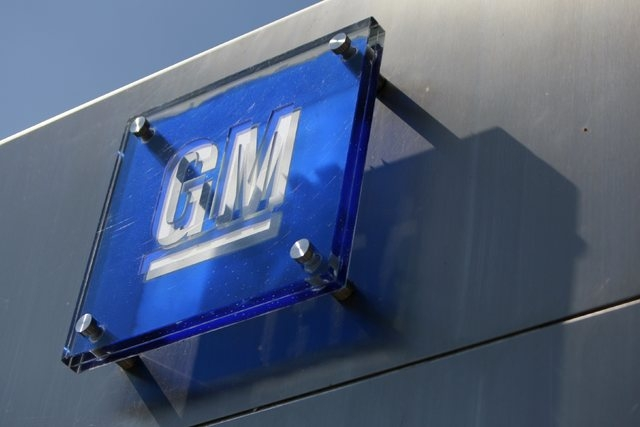 The General Motors logo is seen outside its headquarters at the Renaissance Center in Detroit, Michigan in this file photograph taken August 25, 2009. (Jeff Kowalsky/Reuters)