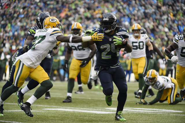 January 18, 2015; Seattle, WA, USA; Seattle Seahawks running back Marshawn Lynch (24) runs the ball against Green Bay Packers cornerback Sam Shields (37) during the second half in the NFC Champion ...