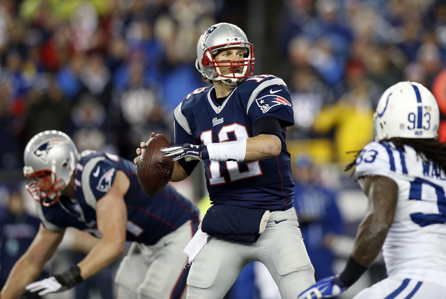 Jan 18, 2015; Foxborough, MA, USA; New England Patriots quarterback Tom Brady (12) throws a pass during the second quarter against the Indianapolis Colts in the AFC Championship Game at Gillette S ...
