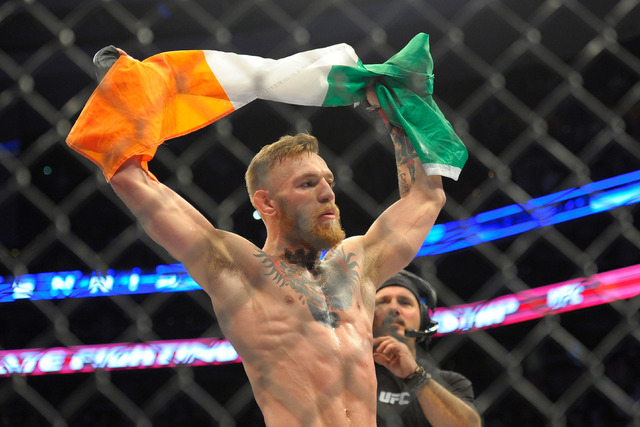 Conor McGregor celebrates his victor over Dennis Siver (not pictured) during a featherweight bout at UFC Fight Night at TD Garden in Boston on Jan. 18, 2015. (Bob DeChiara-USA TODAY Sports)