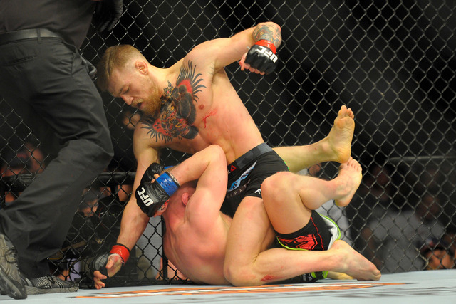 Conor McGregor (red) and Dennis Siver (blue) compete during a featherweight bout at UFC Fight Night at TD Garden in Boston on Jan. 18, 2015. (Bob DeChiara-USA TODAY Sports)