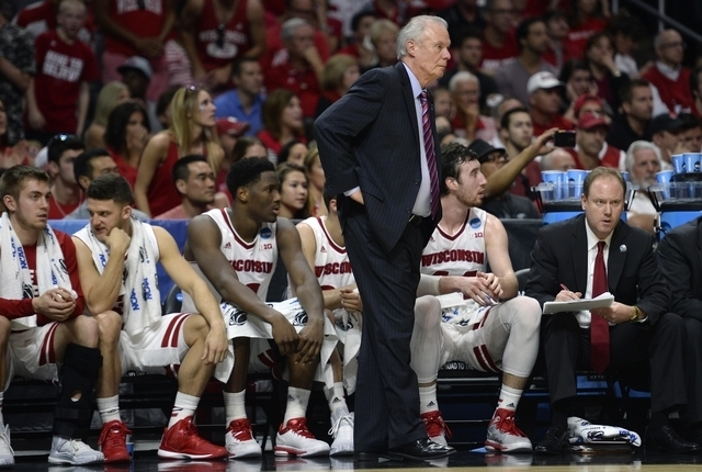 Wisconsin Badgers head coach Bo Ryan watches game action against Arizona Wildcats during the first half in the finals of the West Regional of the 2015 NCAA Tournament at the Staples Center in Los  ...