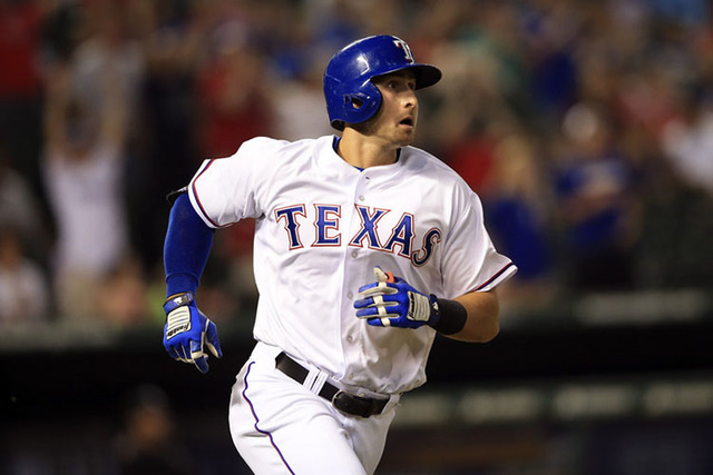 Jun 3, 2015; Arlington, TX, USA; Texas Rangers designated hitter Joey Gallo (13) hits a home run during the ninth inning against the Chicago White Sox at Globe Life Park in Arlington. Mandatory Cr ...