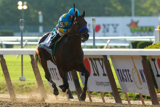 Jun 6, 2015; Elmont, NY, USA; American Pharoah with Victor Espinoza wins the 2015 Belmont Stakes at Belmont Park. (Brad Penner-USA TODAY Sports)
