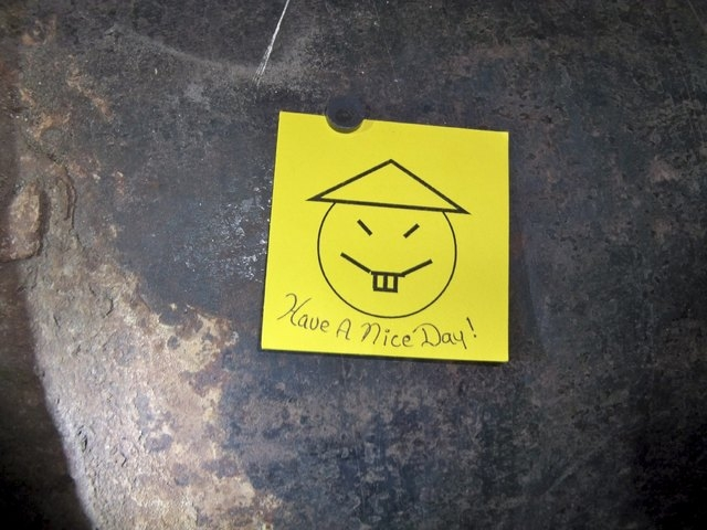 """A note with a caption """"Have a nice day"""" left on an opening in the pipe, where two inmates are suspected to have cut open as part of their escape from Clinton Correctional Facility in Dannemora, Ne ..."""