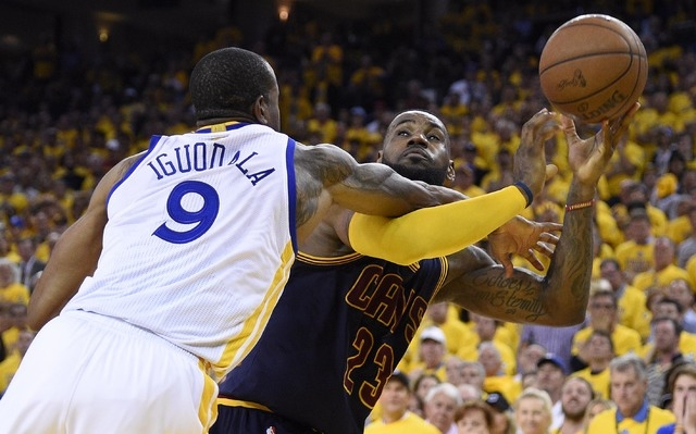 Jun 7, 2015; Oakland, CA, USA; Cleveland Cavaliers forward LeBron James (23) tries to shoot the ball against Golden State Warriors guard Andre Iguodala (9) during overtime in game two of the NBA F ...