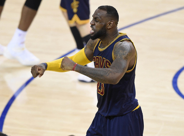 June 7, 2015; Oakland, CA, USA; Cleveland Cavaliers forward LeBron James (23) reacts following the 95-93 victory against the Golden State Warriors in game two of the NBA Finals at Oracle Arena. (B ...
