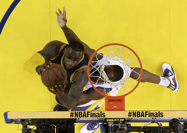 Jun 7, 2015; Oakland, CA, USA; Cleveland Cavaliers forward LeBron James (23) shoots the ball against Golden State Warriors forward Harrison Barnes (40) in game two of the NBA Finals at Oracle Aren ...