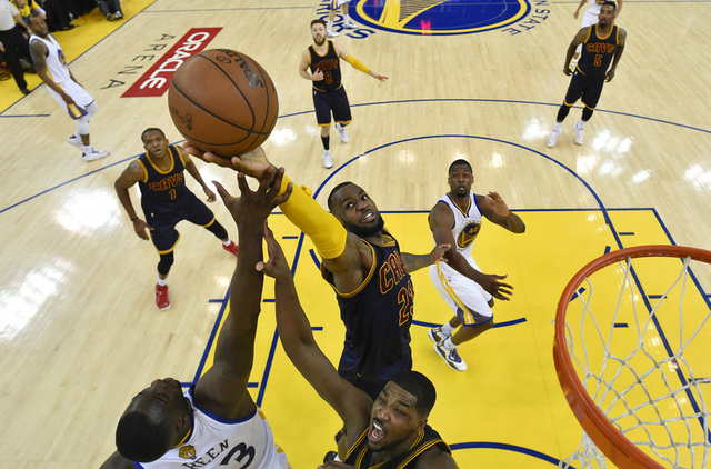Jun 7, 2015; Oakland, CA, USA; Cleveland Cavaliers forward LeBron James (23) and center Tristan Thompson (13) go for rebound against Golden State Warriors forward Draymond Green (23) in game two o ...
