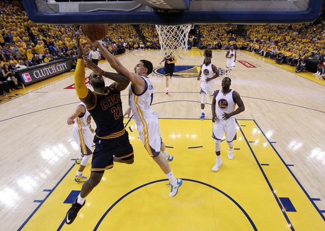 Jun 7, 2015; Oakland, CA, USA; Cleveland Cavaliers forward LeBron James (23) shoots the ball against Golden State Warriors guard Klay Thompson (11) in game two of the NBA Finals at Oracle Arena. ( ...