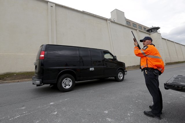 A New York State Correctional Services officer stands guard outside the Clinton Correctional Facility in Dannemora, New York, June 8, 2015. (Reuters/Chris Wattie)