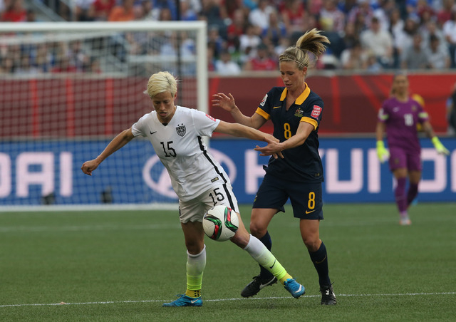 United States midfielder Megan Rapinoe (15) and Australia defender Elise Kellond-Knight (8) battle for control in a Group D soccer match in the 2015 women's World Cup at Winnipeg Stadium on June 8 ...