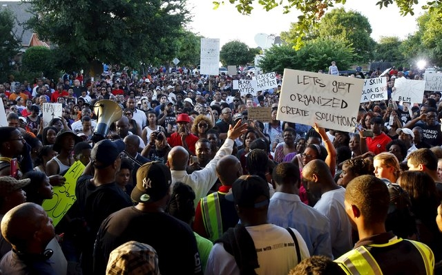 Author David Lee speaks as hundreds of protestors rally against what demonstrators call police brutality in McKinney, Texas June 8, 2015. Hundreds marched through the Dallas-area city of McKinney  ...