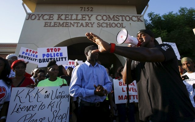 Cory Hughes speaks during a protest against what demonstrators call police brutality in McKinney, Texas June 8, 2015. Hundreds marched through the Dallas-area city of McKinney on Monday calling fo ...