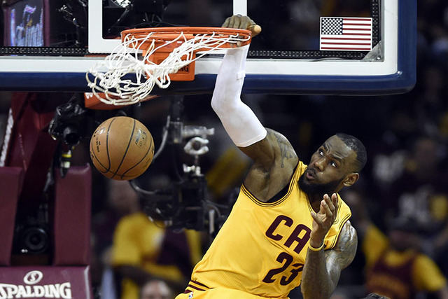 Jun 9, 2015; Cleveland, OH, USA; Cleveland Cavaliers forward LeBron James (23) dunks the ball against the Golden State Warriors during the first quarter in game three of the NBA Finals at Quicken  ...