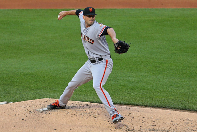 Jun 9, 2015; New York City, NY, USA; San Francisco Giants starting pitcher Chris Heston (53) delivers a pitch against the New York Mets during the first inning at Citi Field. Mandatory Credit: Ada ...