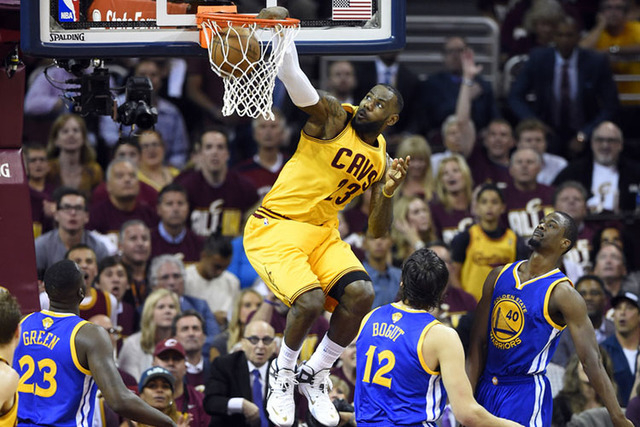 Jun 9, 2015; Cleveland, OH, USA; Cleveland Cavaliers forward LeBron James (23) dunks against Golden State Warriors center Andrew Bogut (12) during the first quarter of game three of the NBA Finals ...