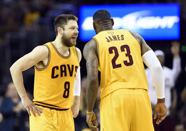 Jun 9, 2015; Cleveland, OH, USA; Cleveland Cavaliers guard Matthew Dellavedova (8) talks with forward LeBron James (23) during the first quarter against the Golden State Warriors in game three of  ...