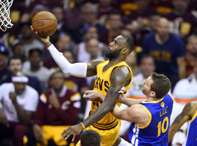 Jun 9, 2015; Cleveland, OH, USA; Cleveland Cavaliers forward LeBron James (23) drives to the basket against Golden State Warriors forward David Lee (10) during the second quarter of game three of  ...
