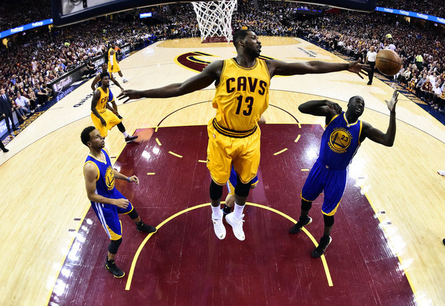 Jun 9, 2015; Cleveland, OH, USA; Cleveland Cavaliers center Tristan Thompson (13) and Cleveland Cavaliers forward LeBron James (23) go for rebound in game three of the NBA Finals. at Quicken Loans ...
