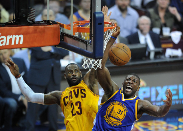Jun 9, 2015; Cleveland, OH, USA; Golden State Warriors center Festus Ezeli (31) reacts after a shot against Cleveland Cavaliers forward LeBron James (23) during the second half of game three of th ...