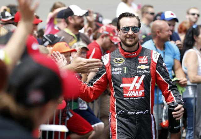 NASCAR driver Kurt Busch high fives fans prior to the Quicken Loans 400 at Michigan International Speedway on June 14, 2015. (Aaron Doster-USA TODAY Sports)
