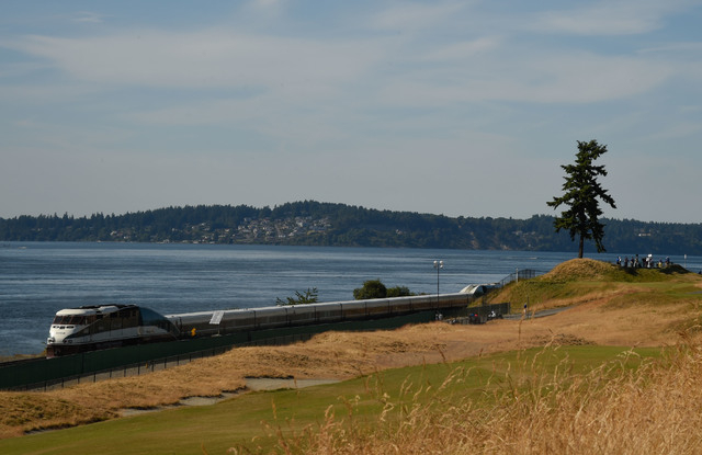 Jun 15, 2015; University Place, WA, USA; General view of the 16th hole as the train goes by during practice rounds on Monday at Chambers Bay. (John David Mercer-USA TODAY Sports)