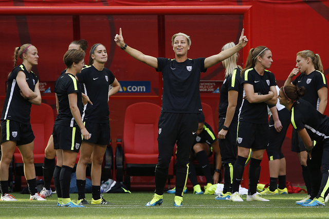 Jun 15, 2015; Vancouver , BC, CAN; United States forward Abby Wambach (C) points at the roof during a training session for the 2015 women's soccer World Cup at BC Place. (Michael Chow-USA TODAY Sp ...