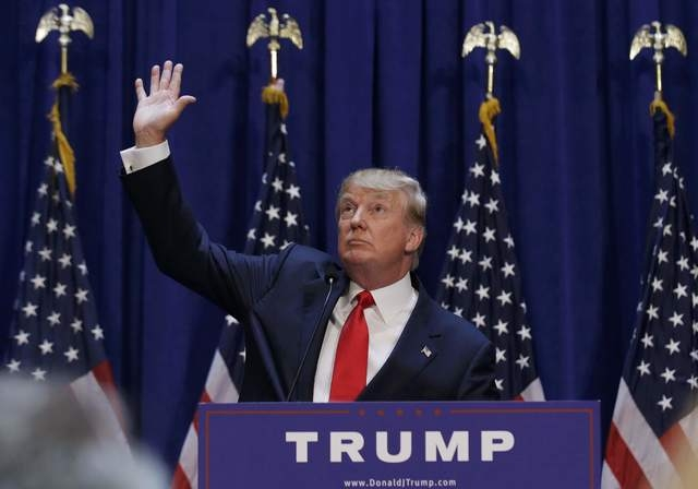 U.S. Republican presidential candidate, real estate mogul and TV personality Donald Trump waves as the crowd cheers after he said that he is going to run for the 2016 Republican presidential nomin ...
