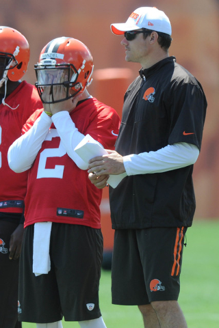 Jun 16, 2015; Berea, OH, USA; Cleveland Browns quarterback Johnny Manziel (2) and quarterbacks coach Kevin O'Connell during minicamp at the Cleveland Browns practice facility. (Ken Blaze-USA TODAY ...