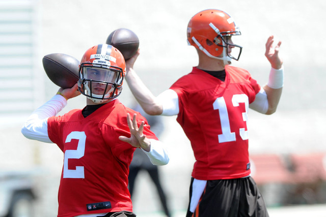Jun 16, 2015; Berea, OH, USA; Cleveland Browns quarterback Johnny Manziel (2) and Cleveland Browns quarterback Josh McCown (13) during minicamp at the Cleveland Browns practice facility. (Ken Blaz ...