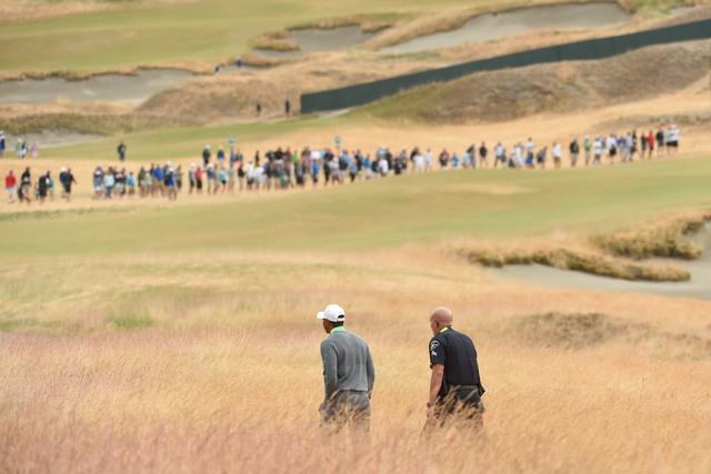 Jun 16, 2015; University Place, WA, USA; Tiger Woods walks up the seventh fairway during practice rounds on Tuesday at Chambers Bay. Mandatory Credit: John David Mercer-USA TODAY Sports