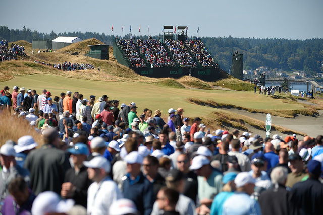 Jun 17, 2015; University Place, WA, USA; General view of the 16th hole with the gallery following Rory McIlroy (not pictured) during practice rounds on Wednesday at Chambers Bay. (John David Merce ...