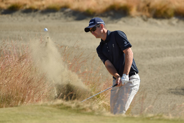 Jun 17, 2015; University Place, WA, USA; Justin Rose hits out of the bunker on the 15th hole during practice rounds on Wednesday at Chambers Bay. (John David Mercer-USA TODAY Sports)