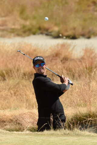 Jun 17, 2015; University Place, WA, USA; Adam Scott hits a bunker shot on the 15th hole during practice rounds on Wednesday at Chambers Bay. (John David Mercer-USA TODAY Sports)