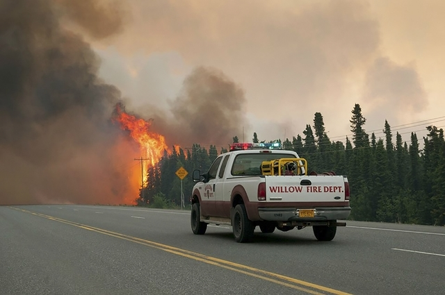 Willow Fire Capt. Leo Lashock responds to an out of control wildfire burning near Willow, Alaska, in this picture courtesy of Mat-Su Borough taken June 14, 2015. (REUTERS/Mat-Su Borough/Stefan Hin ...