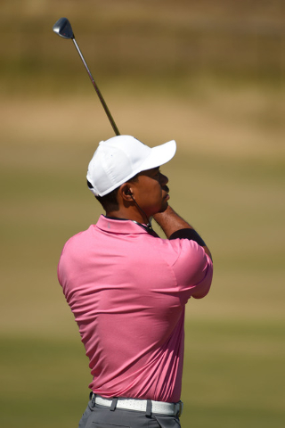 Jun 17, 2015; University Place, WA, USA; Tiger Woods watches his golf ball on the driving range during practice rounds on Wednesday at Chambers Bay. Mandatory Credit: John David Mercer-USA TODAY S ...