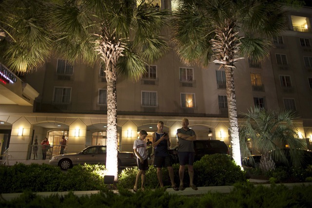 Guests of the Courtyard Mariott on Calhoun Street watch the scene as police respond to a shooting at the Emanuel AME Church in Charleston, South Carolina June 17, 2015. A gunman opened fire on Wed ...