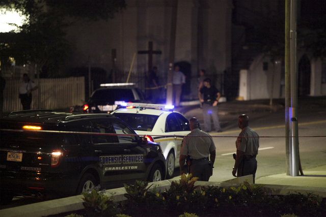 Police respond to a shooting at the Emanuel AME Church in Charleston, South Carolina June 17, 2015. A gunman opened fire on Wednesday evening at the historic African-American church in downtown Ch ...