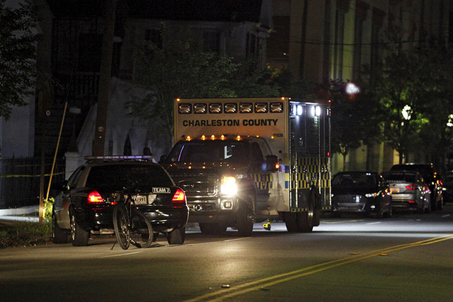 Police respond to a shooting at the Emanuel AME Church in Charleston, South Carolina, June 17, 2015. A gunman opened fire on Wednesday evening at the historic African-American church in downtown C ...