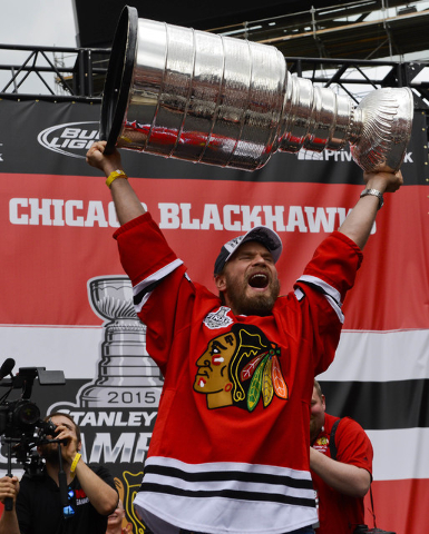 Jun 18, 2015; Chicago, IL, USA; Chicago Blackhawks defenseman Kimmo Timonen (44) holds the Stanley Cup Trophy up during the 2015 Stanley Cup championship rally at Soldier Field. (Matt Marton-USA T ...