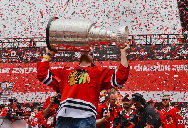 Jun 18, 2015; Chicago, IL, USA; CChicago Blackhawks right wing Marian Hossa (81) kisses the Stanley Cup Trophy during the 2015 Stanley Cup championship rally at Soldier Field. (Matt Marton-USA TOD ...