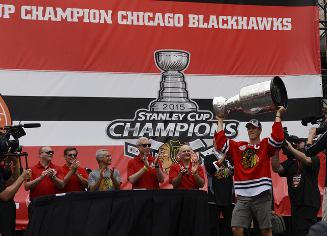Jun 18, 2015; Chicago, IL, USA; Chicago Blackhawks center Jonathan Toews (19) carries the Stanley Cup trophy into the rally during the 2015 Stanley Cup championship rally at Soldier Field. (Matt M ...
