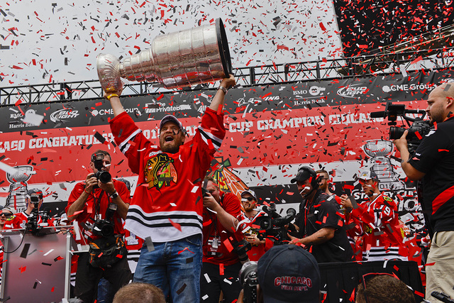 Jun 18, 2015; Chicago, IL, USA; Chicago Blackhawks defenseman Kimmo Timonen (44) holds the Stanley Cup up during the 2015 Stanley Cup championship rally at Soldier Field. (Matt Marton-USA TODAY Sp ...