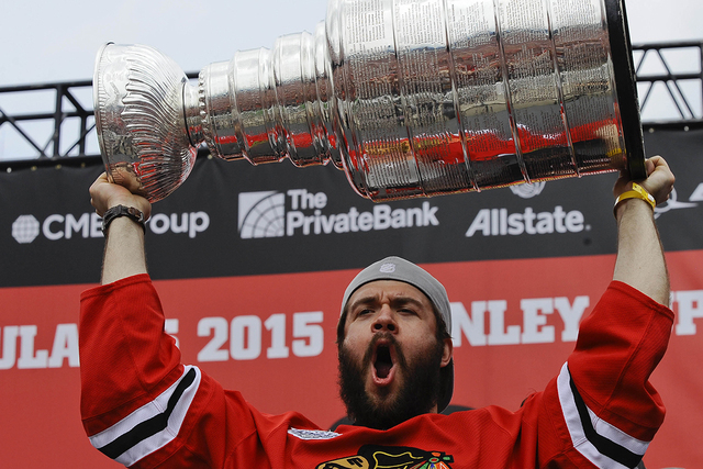 Jun 18, 2015; Chicago, IL, USA; Chicago Blackhawks defenseman Brent Seabrook (7) yells after he kissed the Stanley Cup trophy  during the 2015 Stanley Cup championship rally at Soldier Field. (Mat ...