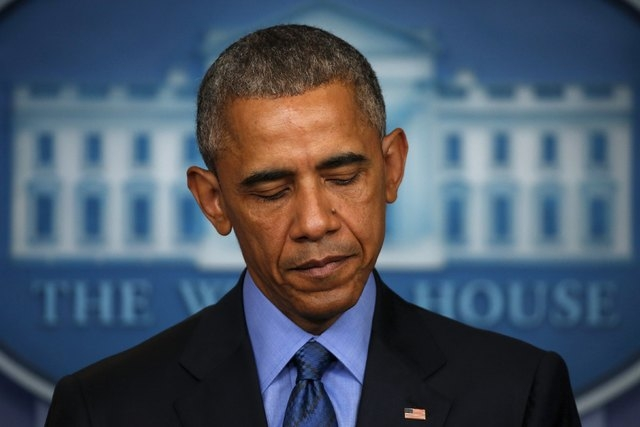 U.S. President Barack Obama delivers remarks in reaction to the shooting deaths of nine people at an African-American church in Charleston, South Carolina, from the podium in the press briefing ro ...